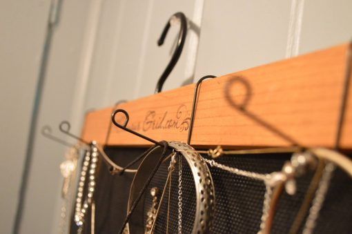 necklaces-and-bracelet-hanging-from-organizer
