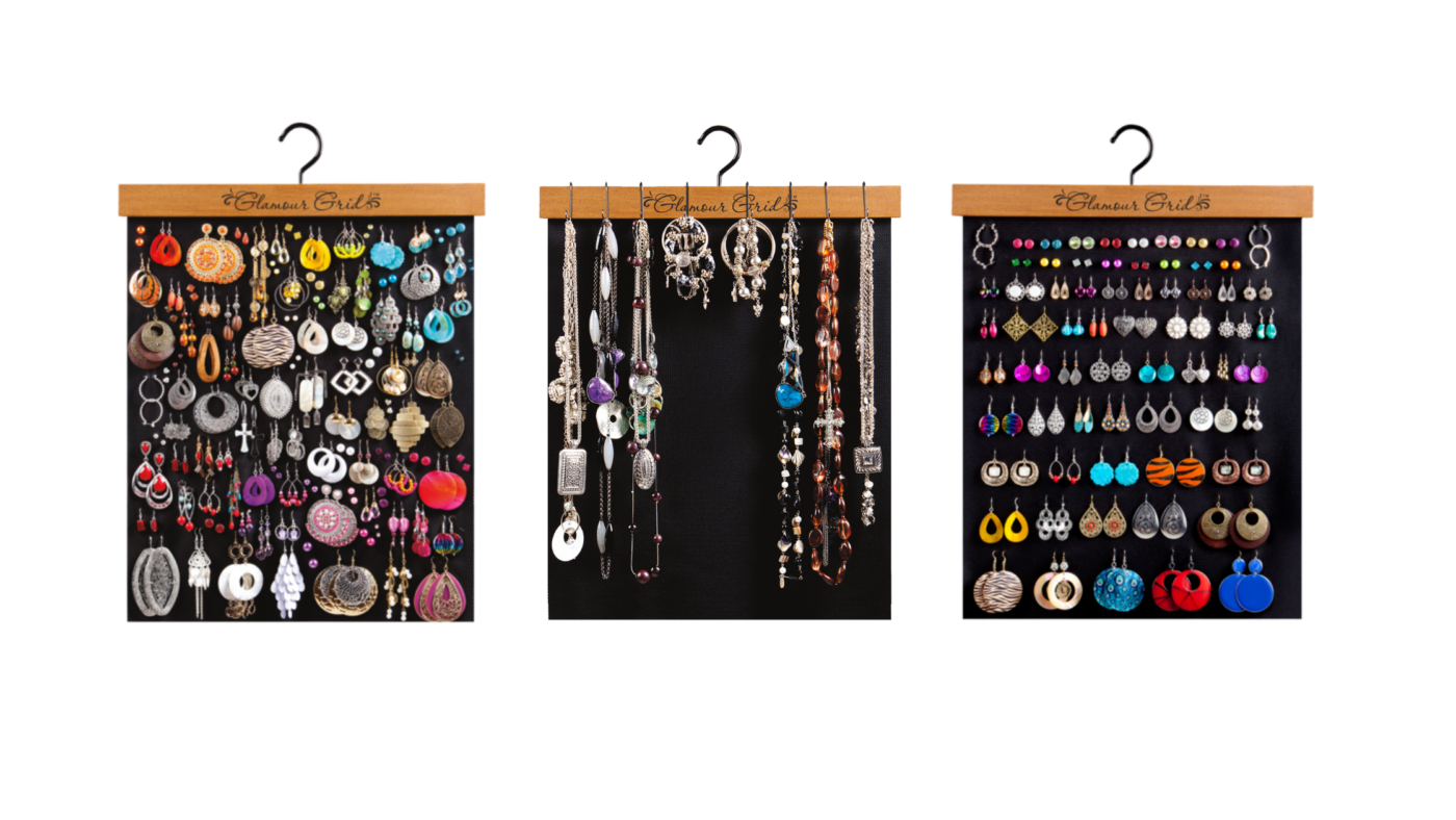 3 earring and necklace organizers in a row across with many pieces of jewelry neatly organized together